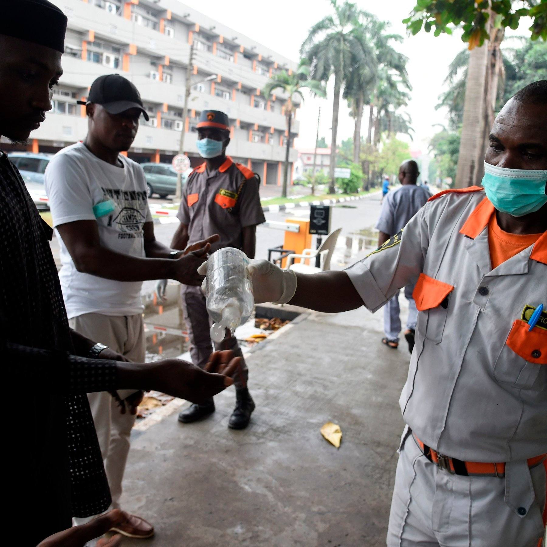 Yaounde, Cameroon: A health official disinfects hands of citizens in a bid to save them from catching Coronavirus